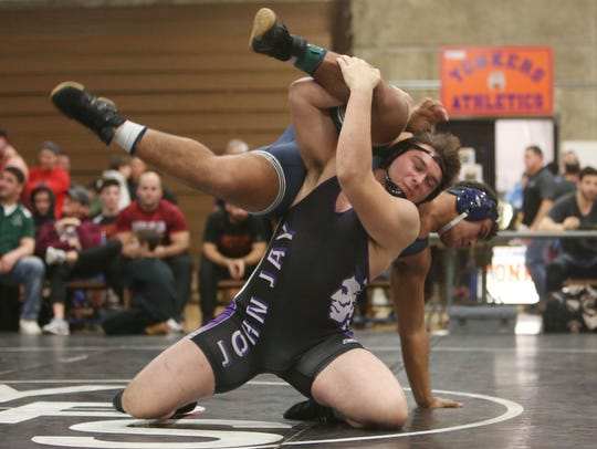 John Jay's Halil Gecaj on his way to defeating Rye