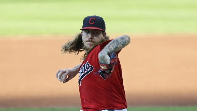 Cleveland Indians starting pitcher Mike Clevinger delivers in the first inning in a baseball game against the Cincinnati Reds, Wednesday, Aug. 5, 2020, in Cleveland.