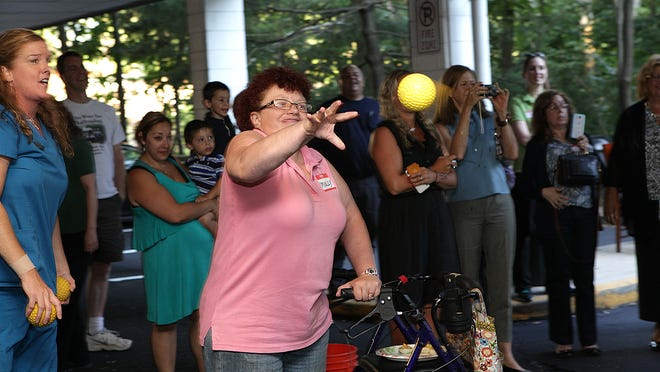 All eyes are on Molly Ferguson from Stanhope as she attempts to hit the dunk tank target at the Atlantic Neurosurgical Specialists Center of Hope Foundation's picnic.