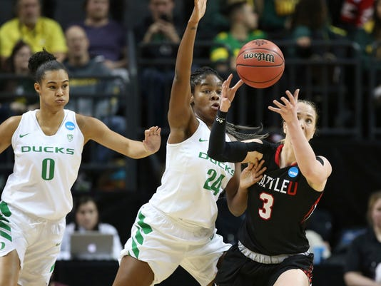 Oregon's Satou Sabally, left, and Ruthy Hebard pressure Seattle's Jacinta Beckley during the second quarter of a first-round game in the NCAA women's college basketball tournament in Eugene, Ore., Friday, March 16, 2018. (AP Photo/Chris Pietsch)