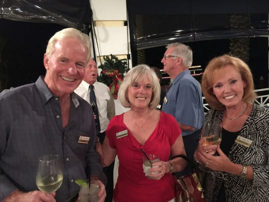 From left, Jim McKeown, Kathy Caruso and Marcia Conley enjoy drinks.