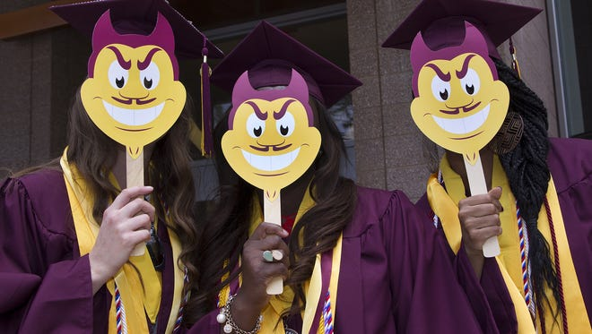Arizona State University nursing students pose for a silly photo at the downtown campus before marching down 3rd Street to the Phoenix Convention Center for convocation, Tuesday, May 12, 2015. From left to right are; Preslie Tidwell, Nneka Onyia, and Shaina Welch.