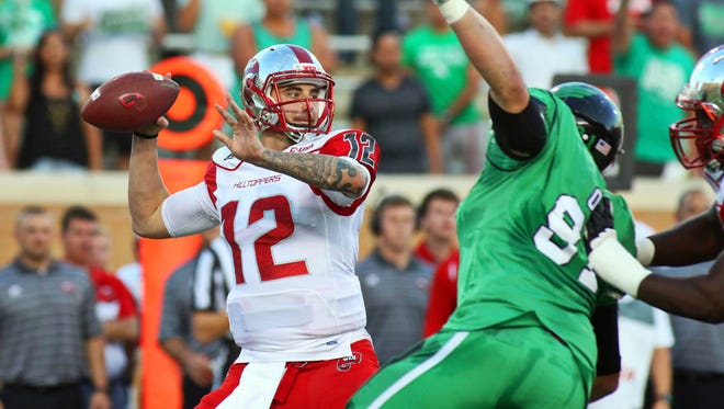 Oct 15, 2015; Denton, TX, USA; Western Kentucky Hilltoppers quarterback Brandon Doughty (12) passes against the North Texas Mean Green during the first quarter of game at Apogee Stadium. Mandatory Credit: Ray Carlin-USA TODAY Sports