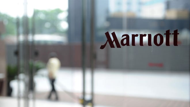 Guests wait outside the new Marriott hotel in Beijing. FRANKO LEEFranko Lee/AFP/Getty Images