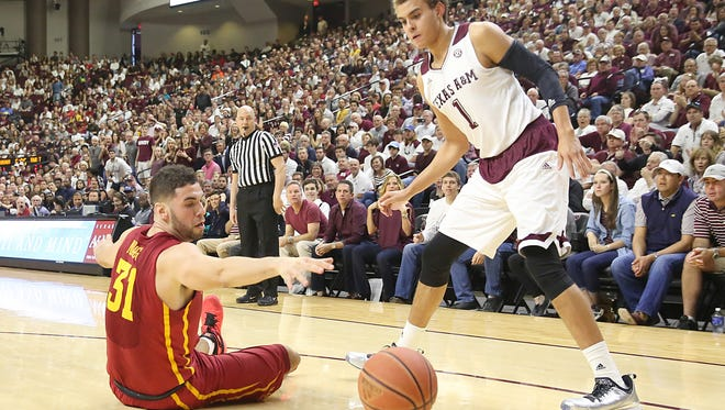 Iowa State forward Georges Niang (31) and Texas A&M Aggies forward DJ Hogg (1) react to a loose ball in the first half at Reed Arena.