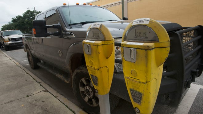 Parking meters in downtown Pensacola are pictured in this file photo.