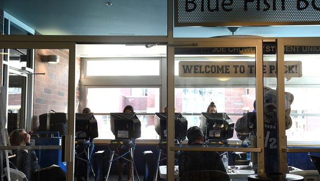 People participate in early voting at the Joe Crowley Student Union on the campus of the University of Nevada, Reno on Nov. 1, 2016.