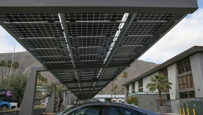 A solar shade structure installed by Hot Purple Energy generates electricity in the parking lot of The Five Hundred building in downtown Palm Springs on Feb. 3, 2017.