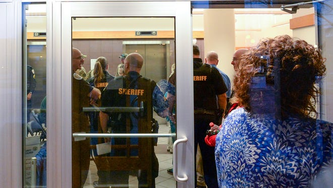 Anderson County Sheriff's Deputies and courthouse employees check in before a waiver hearing for Jesse Osborne, at the Anderson County Courthouse on Monday, February 12, 2018. The hearing will determine how Osborne, now 15, will be treated, as a child or an adult. Osborne is accused of killing his father, 47-year-old Jeffrey Osborne, on Sept. 28, 2016, then driving a pickup truck to Townville Elementary School shooting two students, one six-year old Jacob Hall who died later.