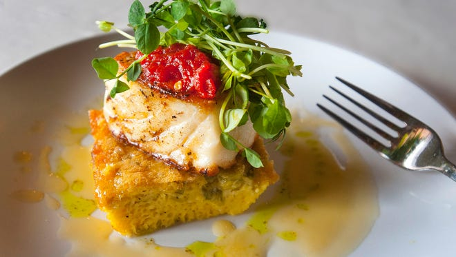 Lilly's Bistro owner and head chef Katherine Cary's Seared Halibut on a Leek Gratin with Tomato Jam and Lemon Beurre Blanc is made with skinless halibut filets, olive oil, kosher salt and a pinch of pepper. The fish sits on a leek gratin made with leeks, butter, parsley, eggs, heavy cream, kosher salt, flour, baking powder and pepper. Grateful Greens' baby pea shoots and tomato jam, made with coarsely chopped whole tomatoes, sugar, olive oil and red pepper flakes, are placed on top of the fish and the dish is coated with a beurre blanc made with lemon juice, white wine, thyme, heavy cream and butter.Mar. 07, 2018