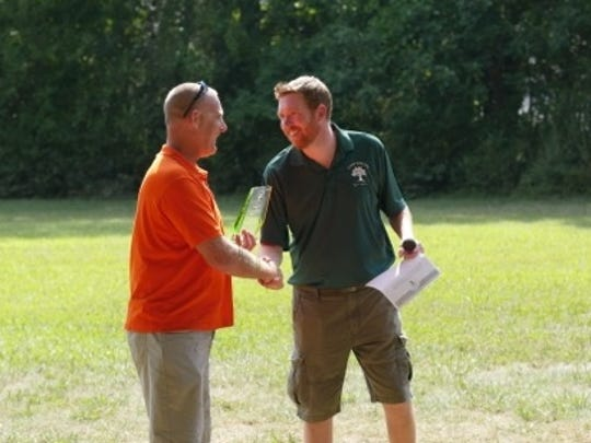 Tim Howarth, Tuner Construction, receives an Award for Volunteer of The Year, from Josh Burke, director of Camp Jotoni.