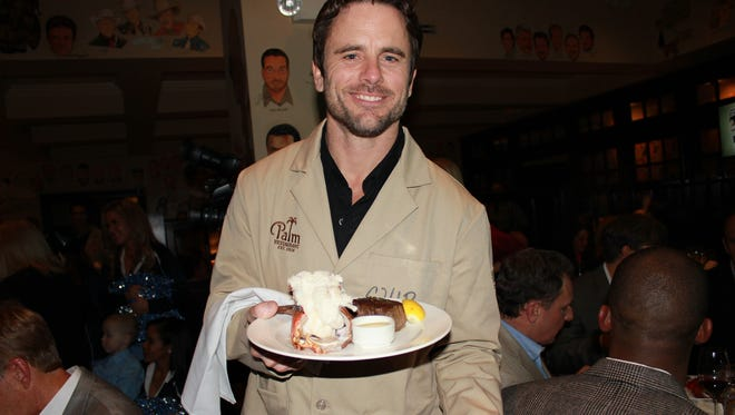 "ABC's ""Nashville"" star Chip Esten is seen here serving guests at Kevin Carter's Waiting for Wishes event benefiting Make-A-Wish Middle Tennessee. While the event happens in spring, it's held at The Palm. Carter is a former NFL star and ESPNU analyst."