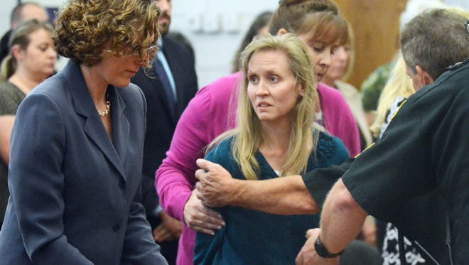In this Sept. 9, 2013, file photo, Carri Williams, center, is taken into custody after she was found guilty of homicide by abuse and manslaughter in the death of her adopted daughter, Hana.