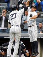 New York Yankees' Giancarlo Stanton (27) celebrates