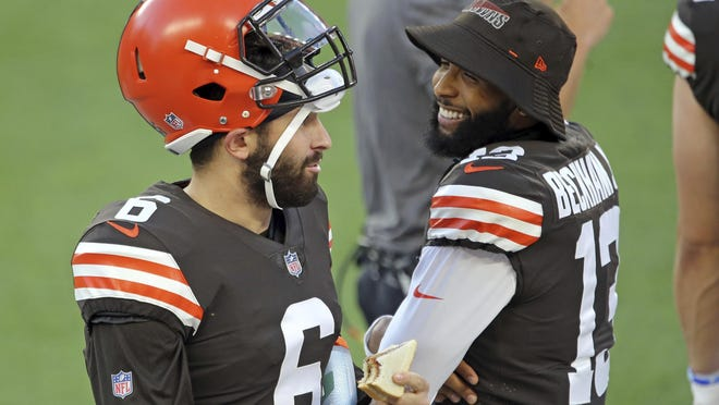 Cleveland Browns quarterback Baker Mayfield and wide receiver Odell Beckham Jr. talk during a scrimmage at FirstEnergy Stadium in Cleveland on Sept. 4. Mayfield said he will stand for the national anthem before Sunday's opener against the Baltimore Ravens.