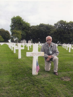 Dale Thoen at the gravesite of his uncle at the Brittany American Cemetery and Memorial in Saint-James, Normandy, France.