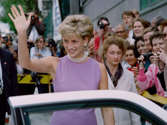 Diana, Princess of Wales, waves to the public as she leaves the Victor Chang Cardiac Research Institute in Sydney on November 1, 1996.