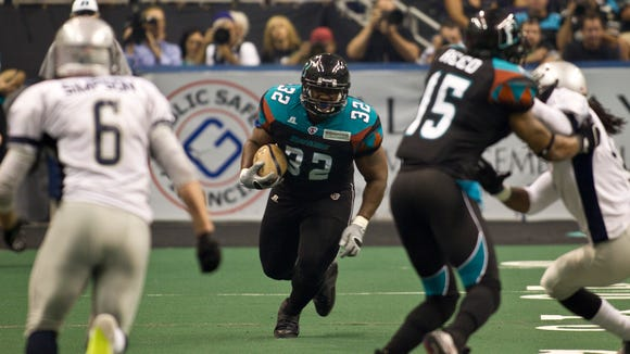 Arizona Rattlers' Odie Armstrong rushes down the sideline against the Chicago Rush in the National Conference finals game at US Airways Center(cq) on August 6, 2011 (cq) in Phoenix, Arizona. Patrick Breen/ The Arizona Republic