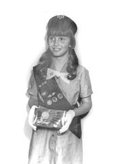 Ten-year-old Kristine Newby standing in her Girl Scouts