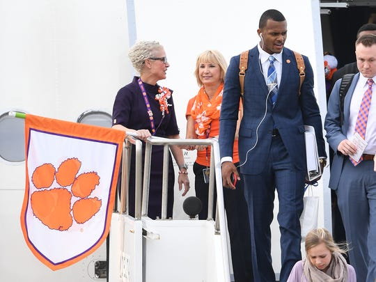 Clemson quarterback Deshaun Watson (4) departs the plane with the rest of the team at Tampa International Airport on Friday, January 6, 2017 for the National Championship game against Alabama on Monday.