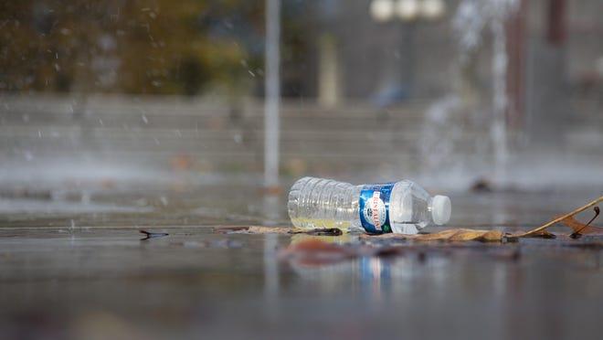 Empty water bottle tossed in a fountain.