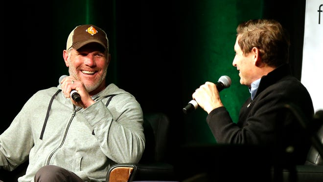Pro Football Hall of Fame quarterbacks Brett Favre and Steve Young share stories from their time playing football during the Bart Starr Chalk Talk luncheon on Nov. 6, 2017 at the KI Convention Center in Green Bay, Wis.