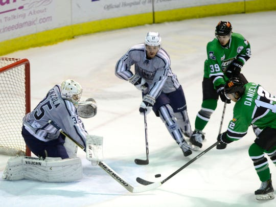 Pensacola Ice Flyers defenseman Jeremy Gates and goaltender