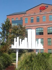 Thomas Burke's Twin Towers Never Forget bird hosue in fron to the AAA building at the Wilmington Riverfront.