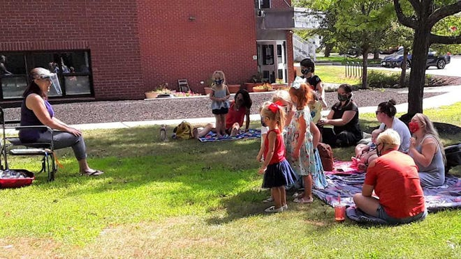 The Rochester Public Library held its first outdoor Pop-Up Story Time recently. The stories were read by Children's Room Librarian Christina Paquette. Keep an eye on the library's Facebook page for days and times of upcoming outdoor Story Times.