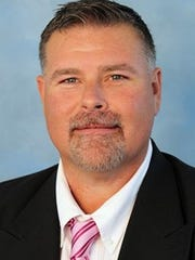 McMurry football coach Lance Hinson