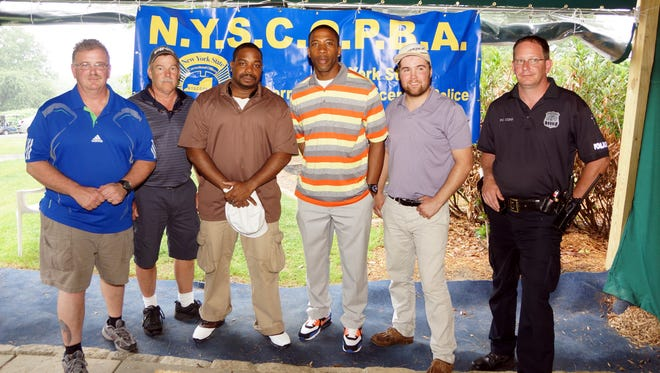 From right to Left: Westchester County Police Officer Matt Cohn, Derek Bernard, James Moore, Tai Tedder, Chuck Koemm and Thomas D. Fitzgerald