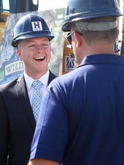 Richmond Mayor Dave Snow laughs during a groundbreaking
