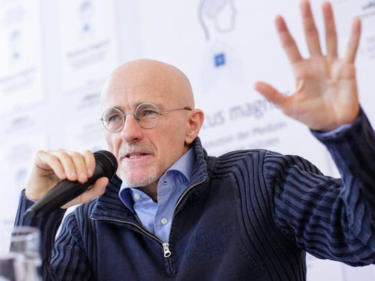Italian neurosurgeon Sergio Canavero gestures as he