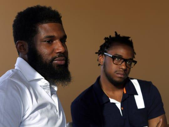Rashon Nelson (left) and Donte Robinson, both 23, listen