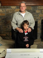 Duane Reh and his son, Mitchell, 9, in their Boone
