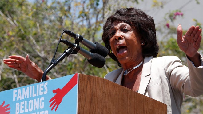 Rep. Maxine Waters, who has received death threats because of her anti-Trump comments, addresses thousands who marched in protest of the  Trump administration's immigration policies on June 30, 2018 in Los Angeles, California.