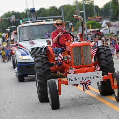 Dr. Larry Swanger drives an antique tractor in the