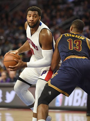 Andre Drummond drives around the Cavaliers' Tristan Thompson in the first  quarter of Game 3.