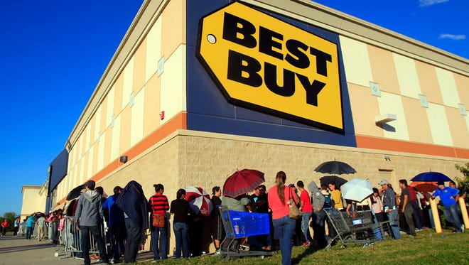 Customers stand in line as they wait for the doors to open during Black Friday 2014 at Best Buy in McAllen, Texas.
