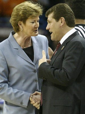 Head coach Pat Summitt of the Tennessee Lady Vols (L) and head coach Geno Auriemma of the University of Connecticut Huskies meet before the National Championship game of the NCAA Women's Final Four Tournament at the New Orleans Arena on April 6, 2004 in New Orleans, Louisiana.