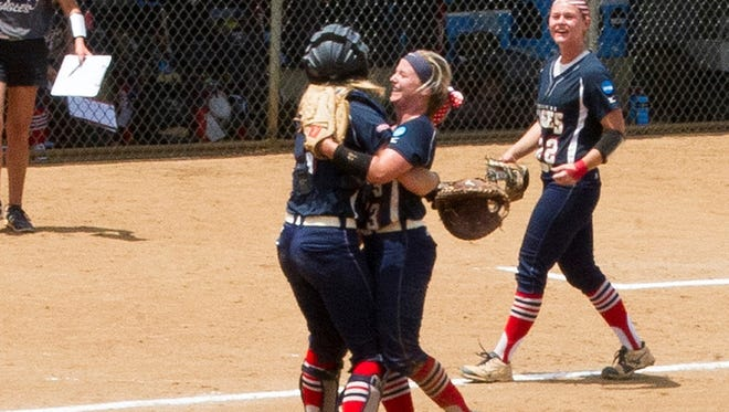 Jennifer Leonhardt celebrates with catcher Lindsey Barr after tossing a no-hitter. USI's won 3-0 over Angelo State in the Division II World Series, Friday.