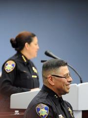 Deputy Chief Daniel Perez smiles as Chief Adele FresŽé speaks about his service on Thursday at the City Hall Rotunda in Salinas.