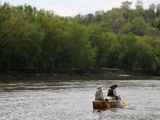 Above, Ben Hoksch and Libby Abbas of Des Moines canoe