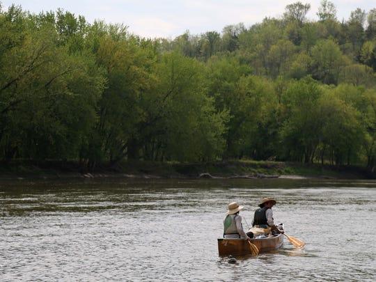 Above, Ben Hoksch and Libby Abbas of Des Moines canoe