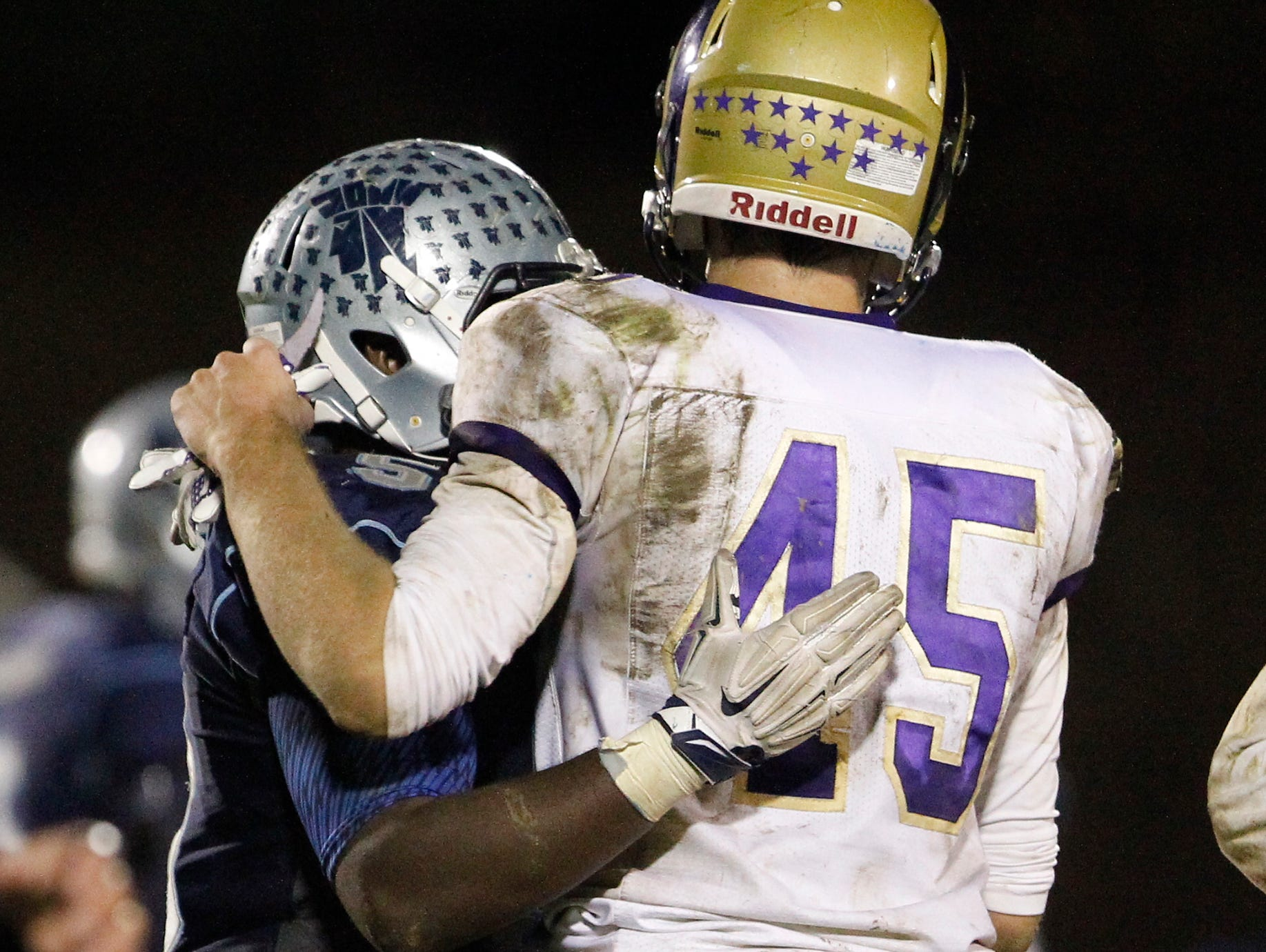 Clarkstown North's Martin Mulvey congratulates John Jay's Andrew Anthony (5) after their 21-7 loss to John Jay High School in the class AA semi-final football game in East Fishkill on Friday, Oct. 30, 2015.
