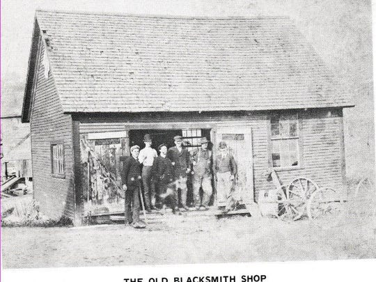 Opposite the square and on the bank of the Black Creek stood the blacksmith shop operated by Fred Jacques. Seen in this picture are from 1906 are William Vaillancourt, George Stebbins, Robert Royce, Arthur Draper, George Bocash and Fred Jacques. To the rear of the store stood many structures, however, the most noticeable was the Alden Brothers Creamery.