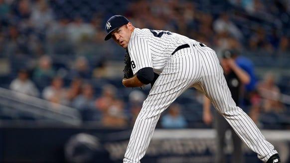 New York Yankees relief pitcher Blake Parker checks