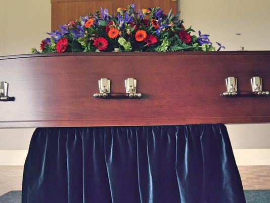 shot of a colorful casket in a hearse or chapel before funeral or burial at cemetery