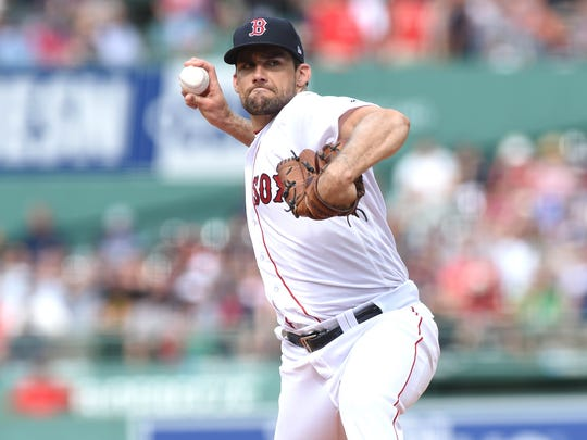 Aug 4, 2018; Boston, MA, USA; Boston Red Sox starting pitcher and ex-Yankee Nathan Eovaldi (17) pitches during the first inning against the New York Yankees at Fenway Park.