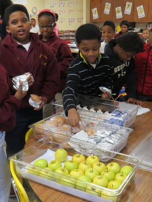 Jackson-Madison County Schools students eat breakfast in the classroom in this photo from last semester.